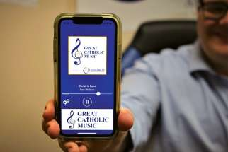 Program director Michael Roberts demonstrates the Great Catholic Music app.