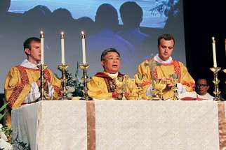Bishop Joseph Nguyen, centre, celebrates Mass after being ordained bishop of Kamloops, B.C.
