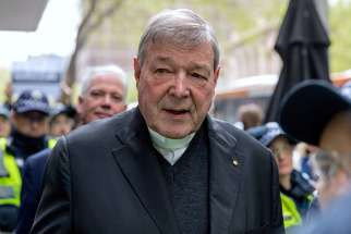 Australian Cardinal George Pell leaves the Melbourne Magistrates Court Oct. 6.