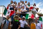 Pilgrims from Mexico pose for a group photo during a tour of the Panama Canal near Panama City Jan. 21, the day before the official opening of World Youth Day in Panama.
