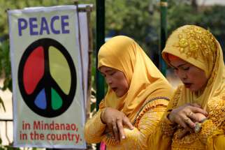 "Muslims pray during the ""All-Out-Peace"" campaign in Manila, Philippines, March 6. Cardinal Orlando Quevedo of the Cotabato Archdiocese, whose population is half Muslim, announced the formation of a separate organization, ""Friends of Peace,"" April 6 in Manila."