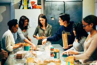 Students made peanut butter and jelly sandwiches to hand out to homeless people on the streets of downtown Toronto.