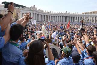 A large crowd greets Pope Francis as he arrives for an audience in mid-June in St. Peter's Square at the Vatican. More than 3.2 million pilgrims visited and attended papal events, liturgies or prayer services at the Vatican in 2015, the Vatican said.