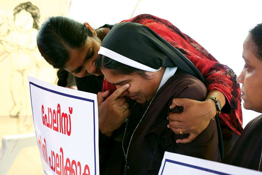 A woman religious is consoled during a protest in Cochin, India, demanding justice after a nun accused Bishop Franco Mulakkal of raping her.