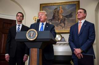 U.S. President Donald Trump makes an announcement on the introduction in the Senate of the Reforming American Immigration for Strong Employment Act, or RAISE, with Sens. Tom Cotton, R-Ark., and David Perdue, R-Ga., at the White House Aug. 2.