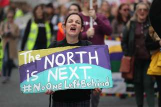 A woman displays a sign during a Sept. 28, 2019, rally in Dublin with other demonstrators who support abortion. Northern Ireland's Catholic and Protestant leaders said the British Parliament decided to impose abortion in Northern Ireland without consulting the people.