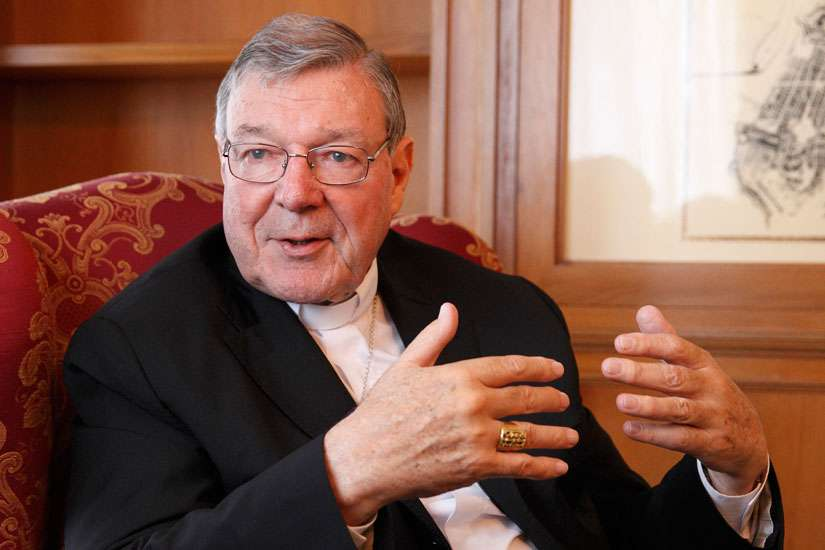 Cardinal George Pell, prefect of the Vatican Secretariat for the Economy, gestures during an interview at the Vatican in this Aug. 5, 2014 file photo.