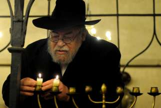 "Czech Rabbi Karol Efraim Sidon lights the menorah of Hanukkah inside Europe's oldest active synagogue, The Old New Synagogue, in Prague, Czech Republic, in this Dec. 2, 2010, file photo. Although Catholics are called to witness to their faith, the church ""neither conducts nor supports"" any institutional missionary initiative directed toward Jews, according to a new document from a Vatican commission"