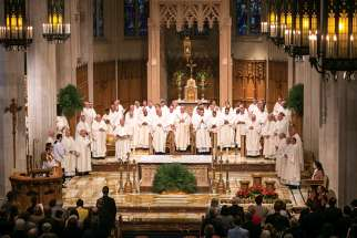 Bishop Douglas Crosby, centre, presided over the service for the Mass of Chrism at Hamilton's Cathedral Basilica of Christ the King on April 15 to begin Holy Week. The liturgy was attended by people representing all segments of the Catholic population.