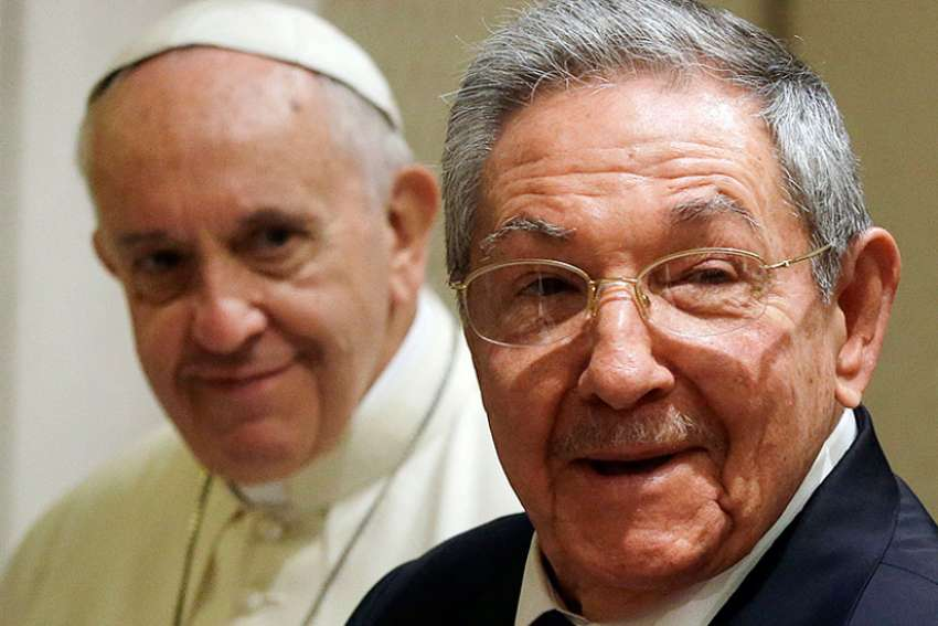 Cuban President Raul Castro, right, smiles as he meets Pope Francis during a private audience at the Vatican on May 10, 2015.