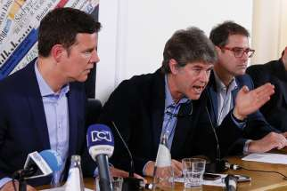 Chilean clerical sex abuse survivors Juan Carlos Cruz, James Hamilton and Jose Andres Murillo attend a news conference at the Foreign Press Association building in Rome May 2.