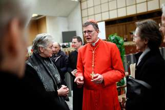 Cardinal Rainer Maria Woelki of Germany receives guests in the Paul VI hall at the Vatican on February 18, 2012.