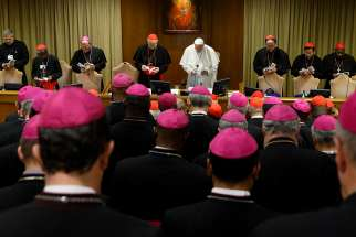 Pope Francis and prelates pray at the start of a session of the Synod of Bishops on young people, the faith and vocational discernment at the Vatican Oct. 11.