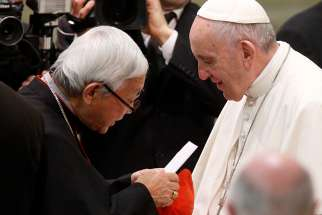 Cardinal Joseph Zen Ze-kiun, retired archbishop of Hong Kong, presents a letter to Pope Francis during his general audience at the Vatican Jan. 10. In a Jan. 29 statement Cardinal Zen said he came to Rome for the sole purpose of personally delivering the letter from Bishop Zhuang Jianjian of Shantou, China. Media reports say Bishop Zhuang, a Vatican-approved bishop, has been asked to step down and that a government-backed bishop would take his place.