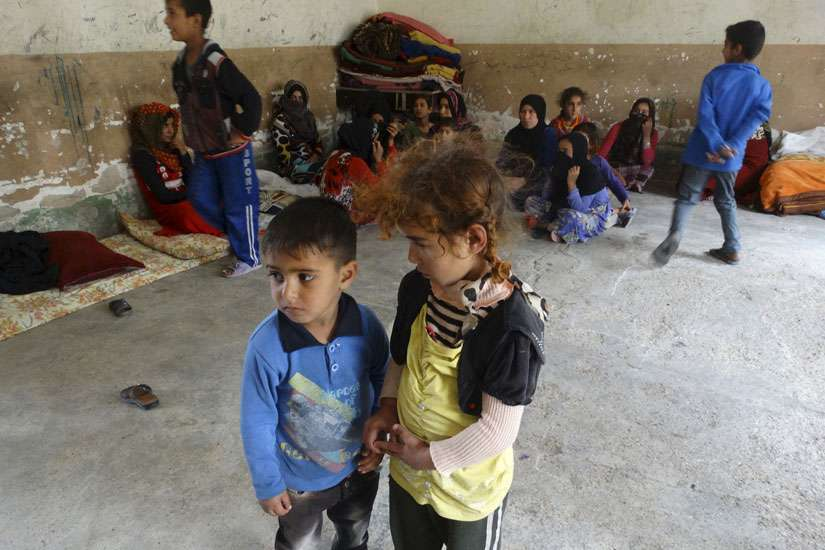 Displaced Iraqi children stand in a classroom of a school used as a shelter in the city of Ramadi April 11.