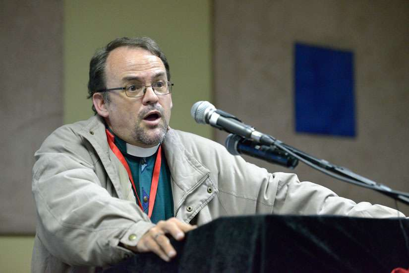 Jesuit Father Anthony Egan, a theologian and lecturer in medical ethics at the Faculty of Health Science at the University of Witwatersrand in Johannesburg, speaks at a panel discussion during a July 16 gathering before the International AIDS Conference in Durban, South Africa.