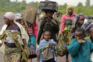 "Villagers walk toward Goma, Congo, to flee regional fighting in 2012. Bishops from eastern Congo criticized the failure of their government and the United Nations to act against ìgenocide, jihadist fundamentalism and Balkanization"" in the country."