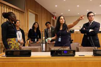 Anna Fata, attache at the Vatican's Permanent Observer Mission to the United Nations, gestures as she leads mission interns on a tour of the U.N. campus Sept. 6. Looking on are Mary Goretti Byamugisha, left, Giulia Iop, Reyna Anderson, Juan Daray and Alexander MacDonald.