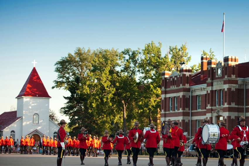 RCMP conduct the Sunset Retreat Ceremony in front of the RCMP chapel in Regina, Sask.