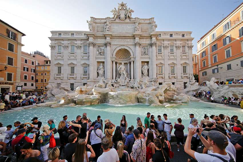 Tourists stand at Rome's Trevi Fountain Aug. 2, 2017.