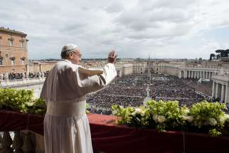 "Pope Francis greets the crowd during his Easter message and blessing ""urbi et orbi"" (to the city and the world) delivered from the central balcony of St. Peter's Basilica at the Vatican April 1."