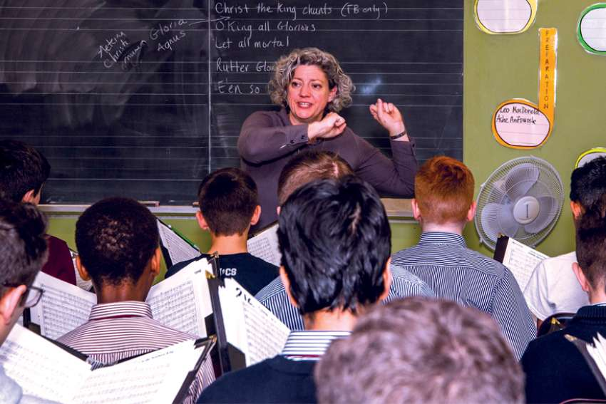 Teri Dunn, Dean of Choral Studies at St. Michael's Choir School, takes the boys through rehearsal prior to the annual Christmas Concert at Toronto's Roy Thomson Hall.