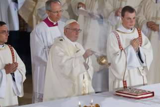 Pope Francis uses incense as he celebrates Mass with priests, religious and consecrated persons at the St. John Paul II Shrine in Lagiewniki, a suburb of Krakow, Poland, July 30.