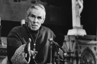 Archbishop Fulton J. Sheen is pictured at a pulpit in an undated file photo.