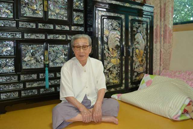 "Kim Bok-dong, 88, poses for a photo in her room at a woman's shelter for ""comfort women"" in Seoul, South Korea, Aug. 19. She was among seven ""comfort women"" who had a private audience with Pope Francis before his final Mass during in South Korea the prev ious day."