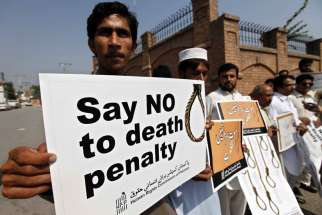 Human rights activists hold placards during a rally in early October against the death penalty in Peshawar, Pakistan.