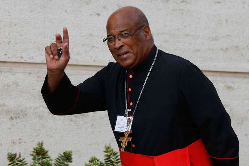 "Cardinal Wilfrid F. Napier of Durban, South Africa, arrives for the morning session of the extraordinary Synod of Bishops on the family at the Vatican Oct. 14. In a series of tweets, Napier says abortion rates among blacks in the U.S. is ""a genocide."""