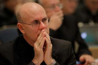 Bishop Kevin C. Rhoades of Fort Wayne-South Bend, Ind., listens to speakers Nov. 16 during the opening of the 2015 fall general assembly of the U.S. Conference of Catholic Bishops in Baltimore.