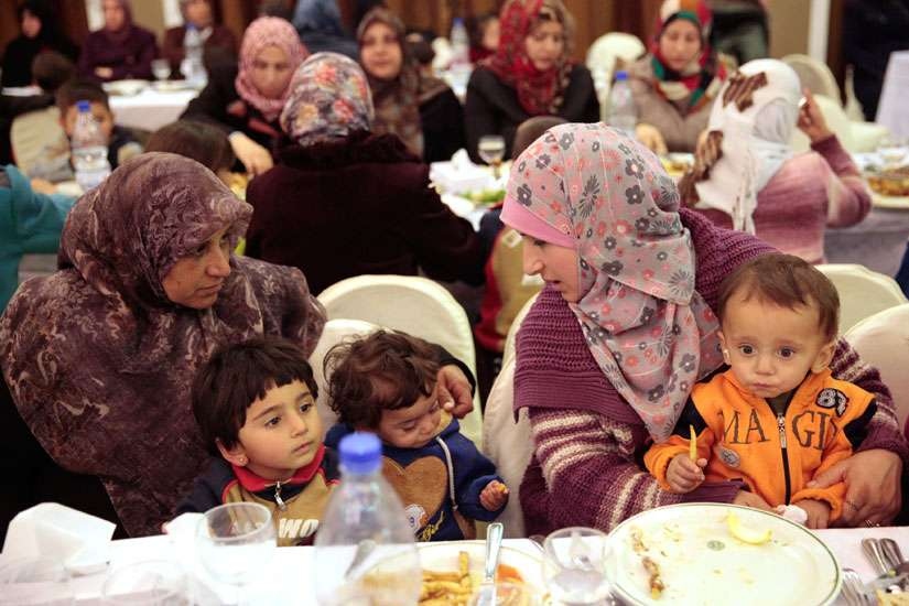 Evacuees from besieged towns in Syria rest at Ebla Hotel in Damascus Dec. 30.