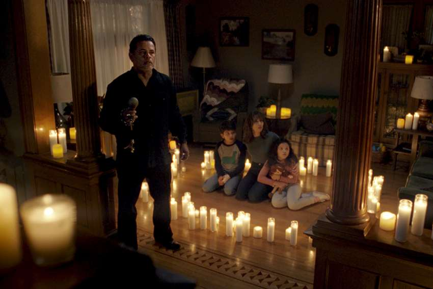 "From left, Raymond Cruz, Roman Christou, Linda Cardellini and Jaynee-Lynne Kinchen star in a scene from the movie ""The Curse of La Llorona."""