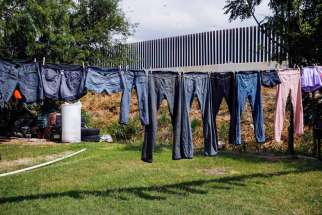 lothes dry in the backyard of a home facing a U.S.-Mexico border fence near Brownsville, Texas, Aug. 5. U.S. and Central American leaders continue to work on approaches to address the situations driving Central Americans to seek refuge in the U.S.