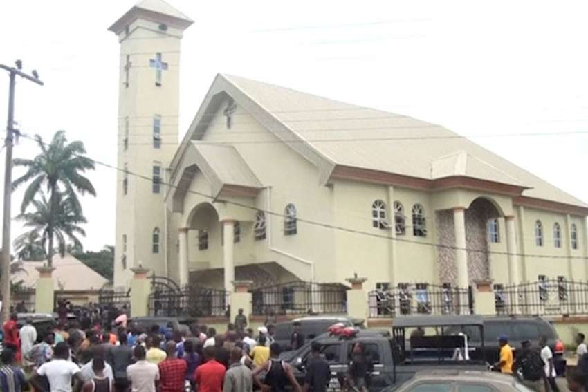A still image taken from a video shows people gathering outside St. Philip Catholic Church following a deadly shooting by unknown gunmen Aug. 6 in Ozubulu, Nigeria. Pope Francis called for an end to violence against Christians following deadly attacks at St. Philip's and at a mission in Gambo, Central African Republic.