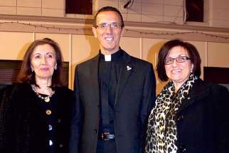 Spiritan Father Roberto Di Nardo, seen here with his sisters, was ordained to the order on May 23.