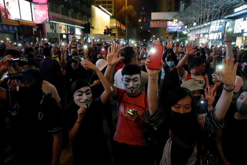 "Anti-government demonstrators protest in Hong Kong Oct. 27, 2019. As protests pitting pro-government groups against pro-democracy protesters continue, a bishop urged Catholics to pray for the realization that all are humans and not ""cockroaches or dogs."""