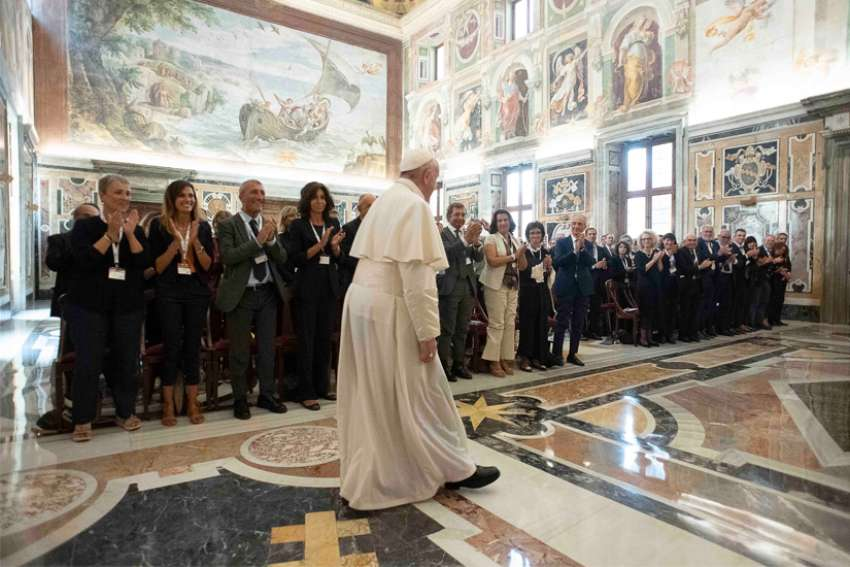 Pope Francis arrives for a meeting with doctors, patients and members of the Italian Association of Medical Oncology at the Vatican Sept. 2, 2019.