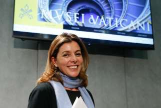 Barbara Jatta, the new director of the Vatican Museums, leaves a Jan. 23 Vatican news conference at which the revamped, mobile-compatible website for the Vatican Museums was unveiled.