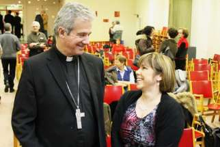 Aid to the Church in Need spokesperson Marie Claude Lalonde, right, speaks with Montreal Archbishop Christian Lepine. Lalonde says that in 60 per cent of countries around the world, religious liberty is compromised.