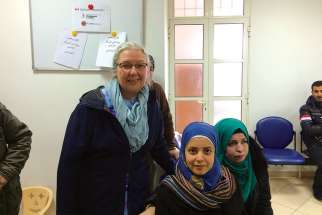 Hélène Tremblay-Boyko with two Syrian refugees, Ghada and Iblissam, at the Caritas Lebanon Medical Centre in Rayfoun (one of 10 throughout Lebanon) which provide medical services to refugees.