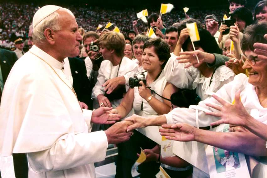 Pope John Paul II greets the crowd at B.C. Place in Vancouver on Sept. 18, 1984. He was given an enthusiastic reception at every stop on his 12-day tour.