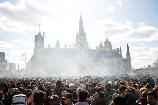 Smoke rises during the annual marijuana rally on Parliament Hill in Ottawa, Ontario, April 20, 2018.