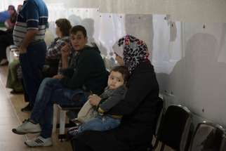 Patients wait for their turn to be treated at St. Anthony's medical dispensary in Beirut. The clinic, run by the Good Shepherd Sisters, functions as a primary health care center, serving Iraqi and Syrian refugees, as well as Lebanon's poor.
