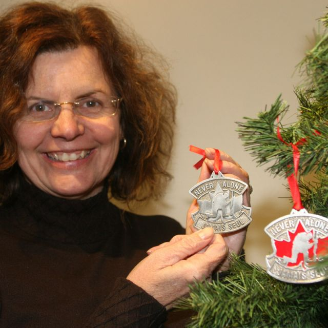 Jane Twohey, a Military Christian Fellowship of Canada volunteer, shows the Christmas ornaments she is helping sell to support Canada's newest war veterans.