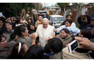 Latin American immigrants in Rome greet Pope Francis Feb. 8.