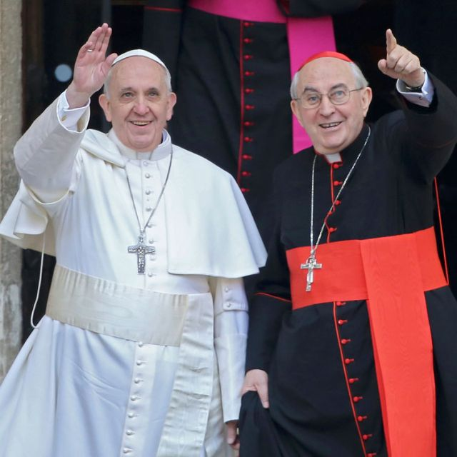 Newly-elected Pope Francis, Cardinal Jorge Mario Bergoglio of Argentina, waves after praying at the Basilica of St. Mary Major in Rome March 14. At right is Cardinal Agostino Vallini, papal vicar for Rome.