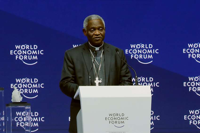Ghanaian Cardinal Peter Turkson, prefect of the Dicastery for Promoting Integral Human Development, speaks Jan. 22 during the opening session of the World Economic Forum in Davos, Switzerland.