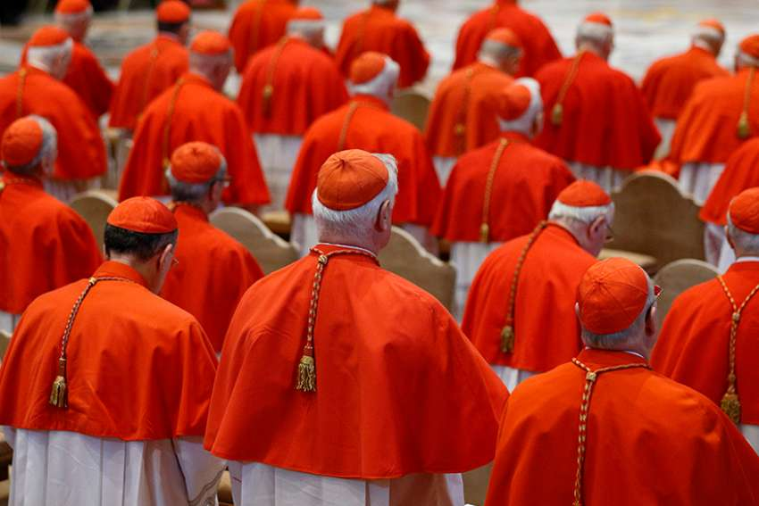 Cardinals attend the Good Friday service led by Pope Francis in St. Peter's Basilica at the Vatican in this March 30 file photo. The pope announced May 20 that he will create 14 new cardinals at a June 29 consistory.